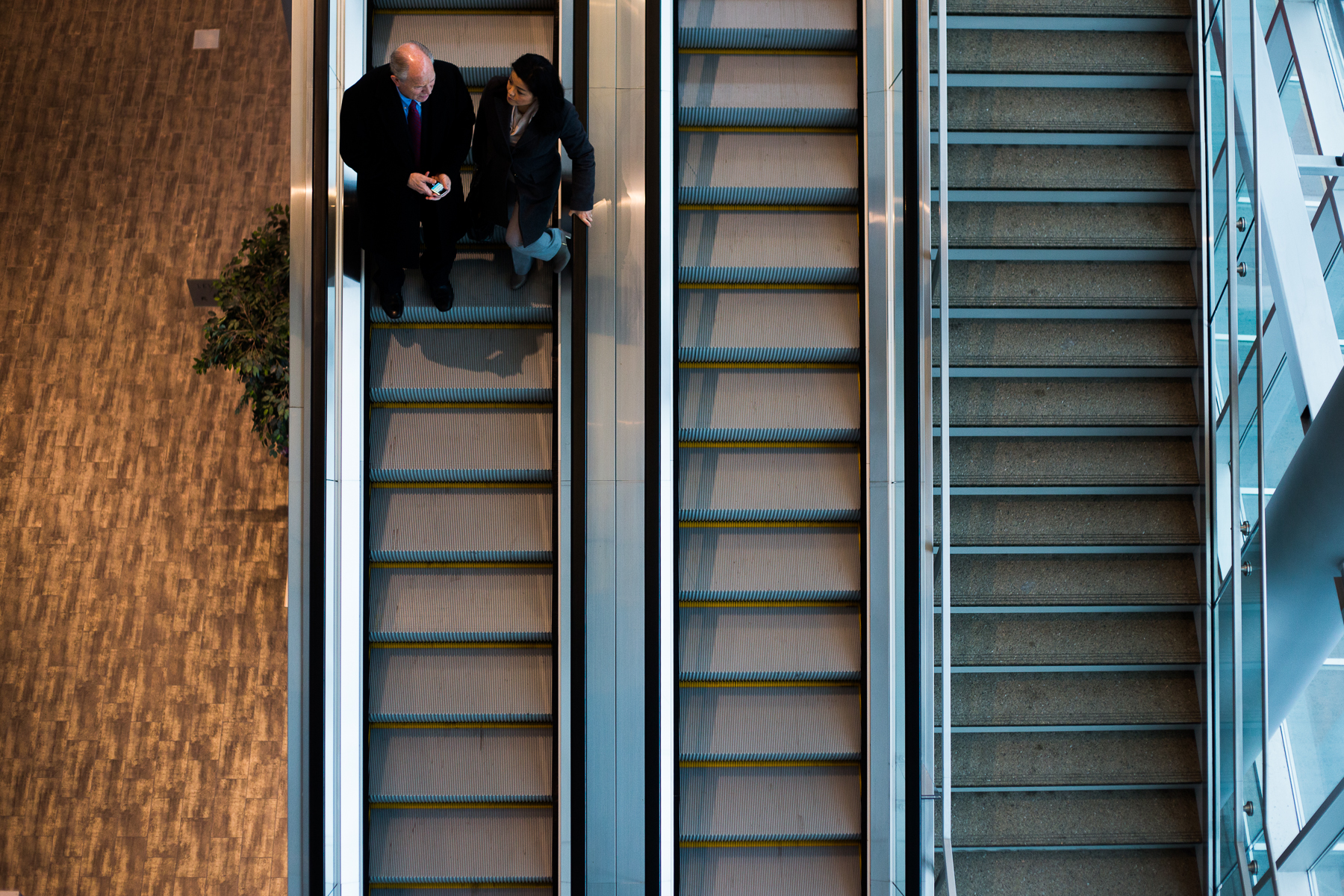 Alaska Governor Elect Bill Walker (left) and Spokesperson Grace Jang left the Dena'ina Center after Walker gave remarks and mingled with attendees at the 35th annual Alaska Resources Conference in Anchorage, Alaska on Thursday, November 20, 2014.