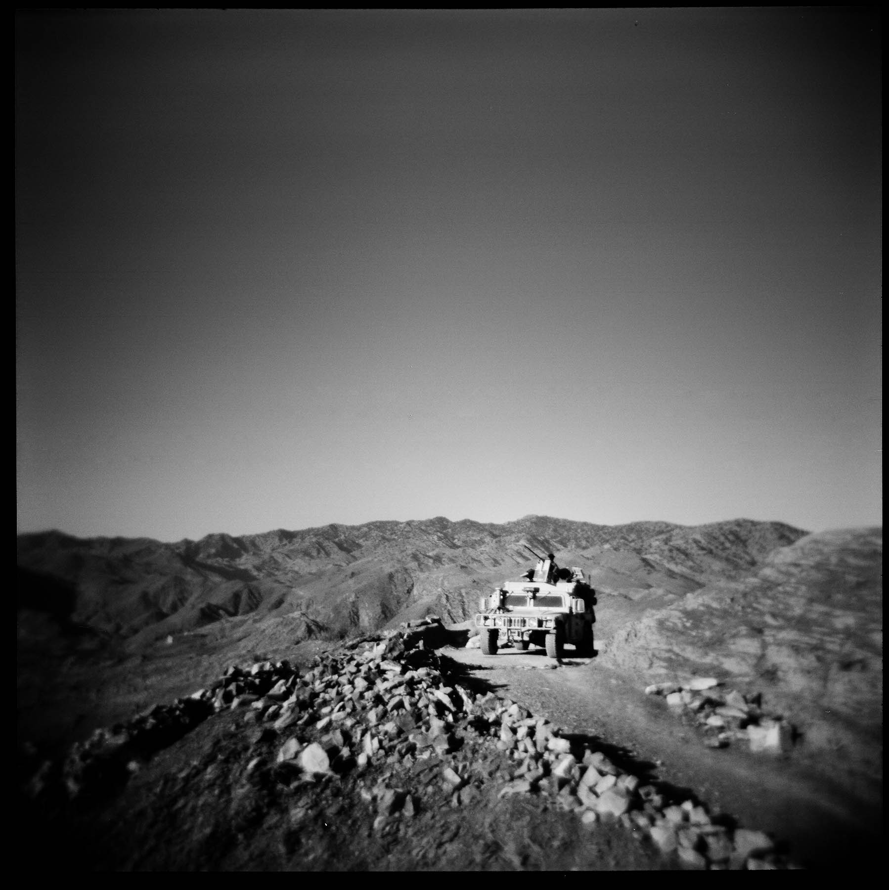 An Afghan Local Police vehicle sets up an overwatch position over the Pirkowti valley in Paktika province, Afghanistan. 2011.