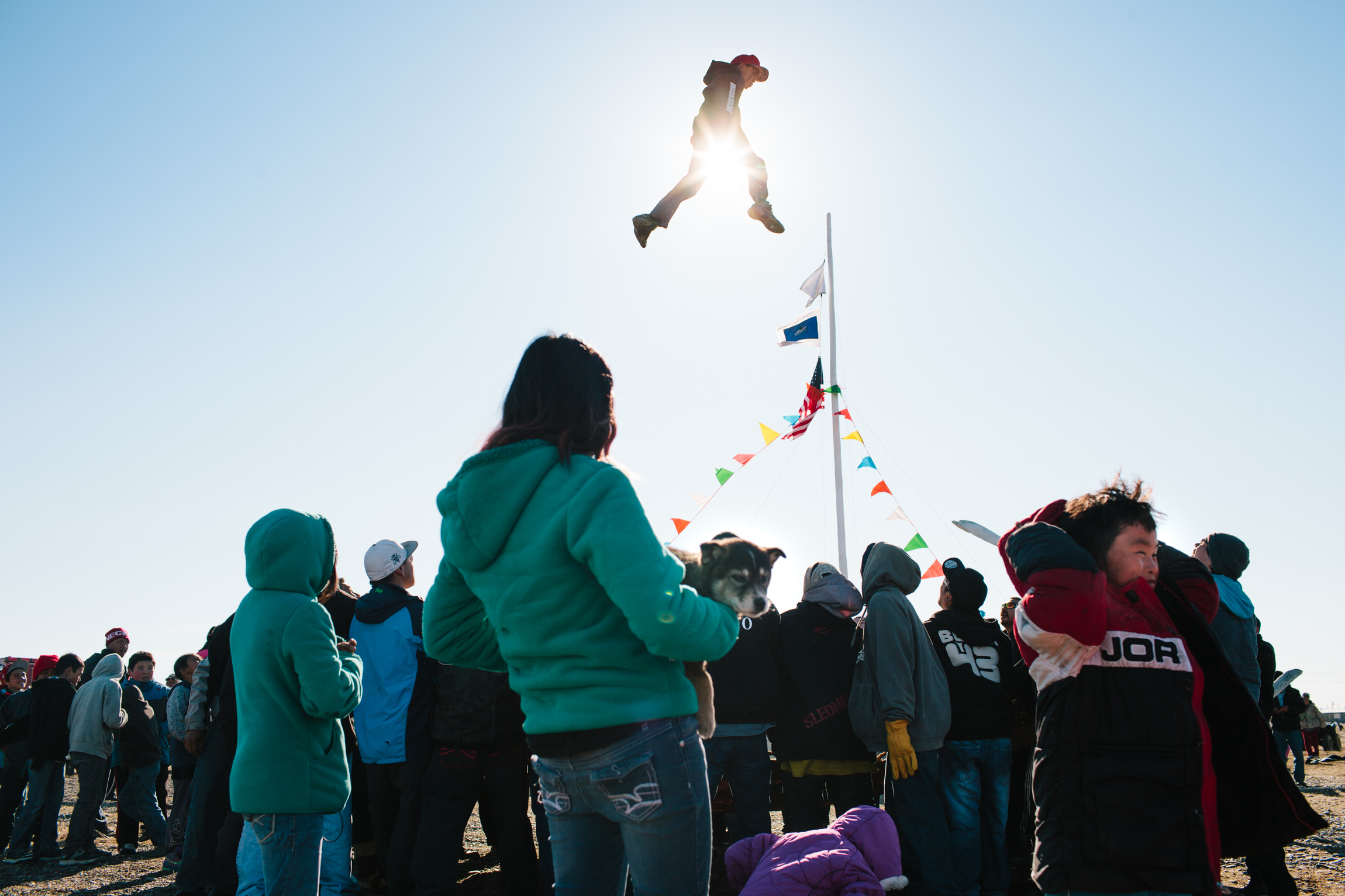 Blanket toss at Point Hope Alaska whaling festival community whale fin carving rural village subsistence