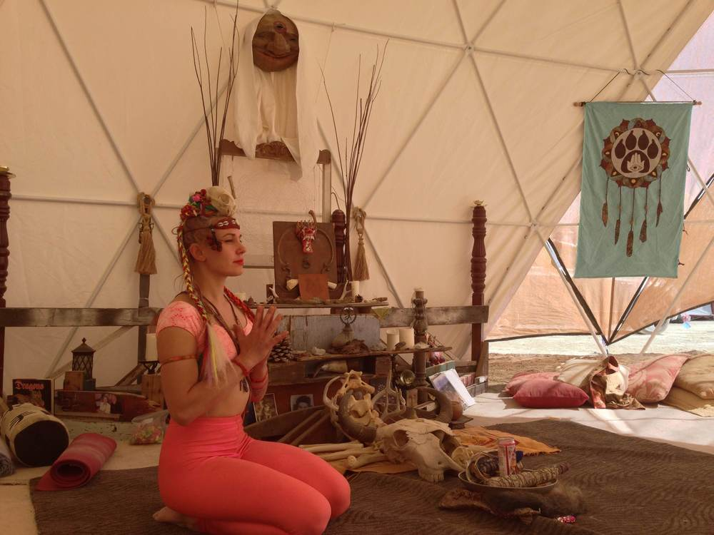 Me teaching a yoga class in the RaisedxWolves yoga dome at BM2014