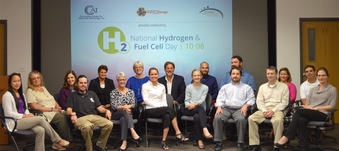 NEESC staff with Hydrogen & Fuel Cell Day Logo