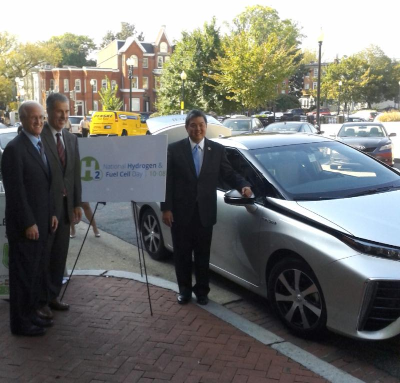 Toyota's Charlie Ing and Robert Wimmer with Representative Mark Takai (D-HI)