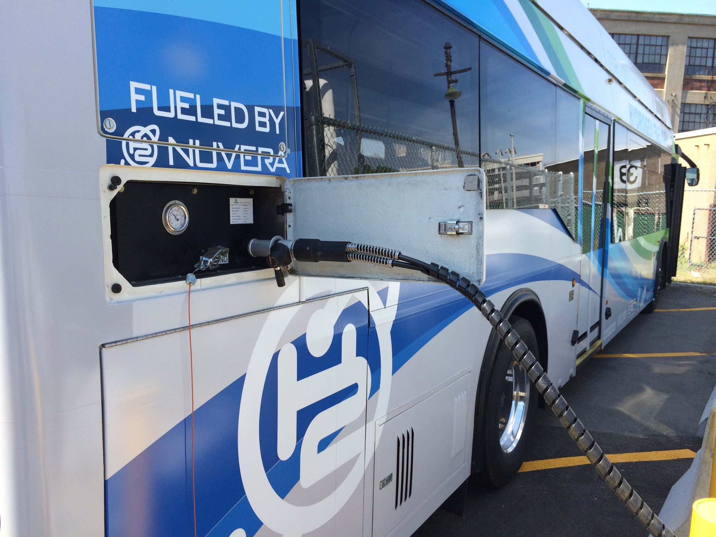 Zero-emissions electric bus being fueled (e.g. repowered) at a station that provides efficient, on-site production of the clean energy carrier, hydrogen.