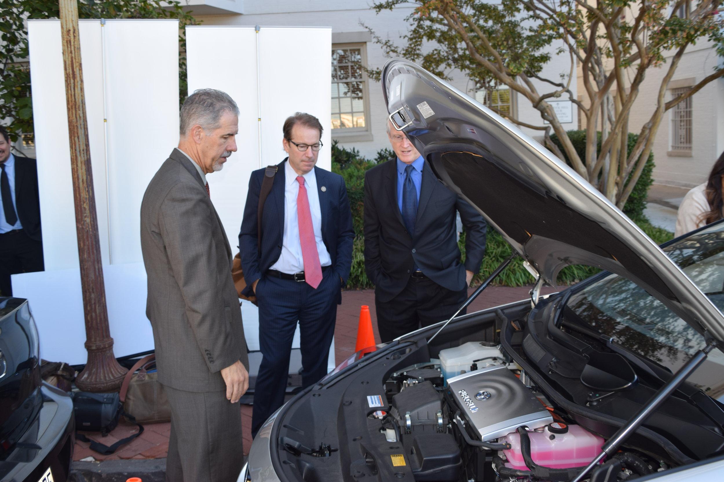 Congressman Peter Roskam (center) examining under the hood of the Toyota Mirai Fuel Cell.