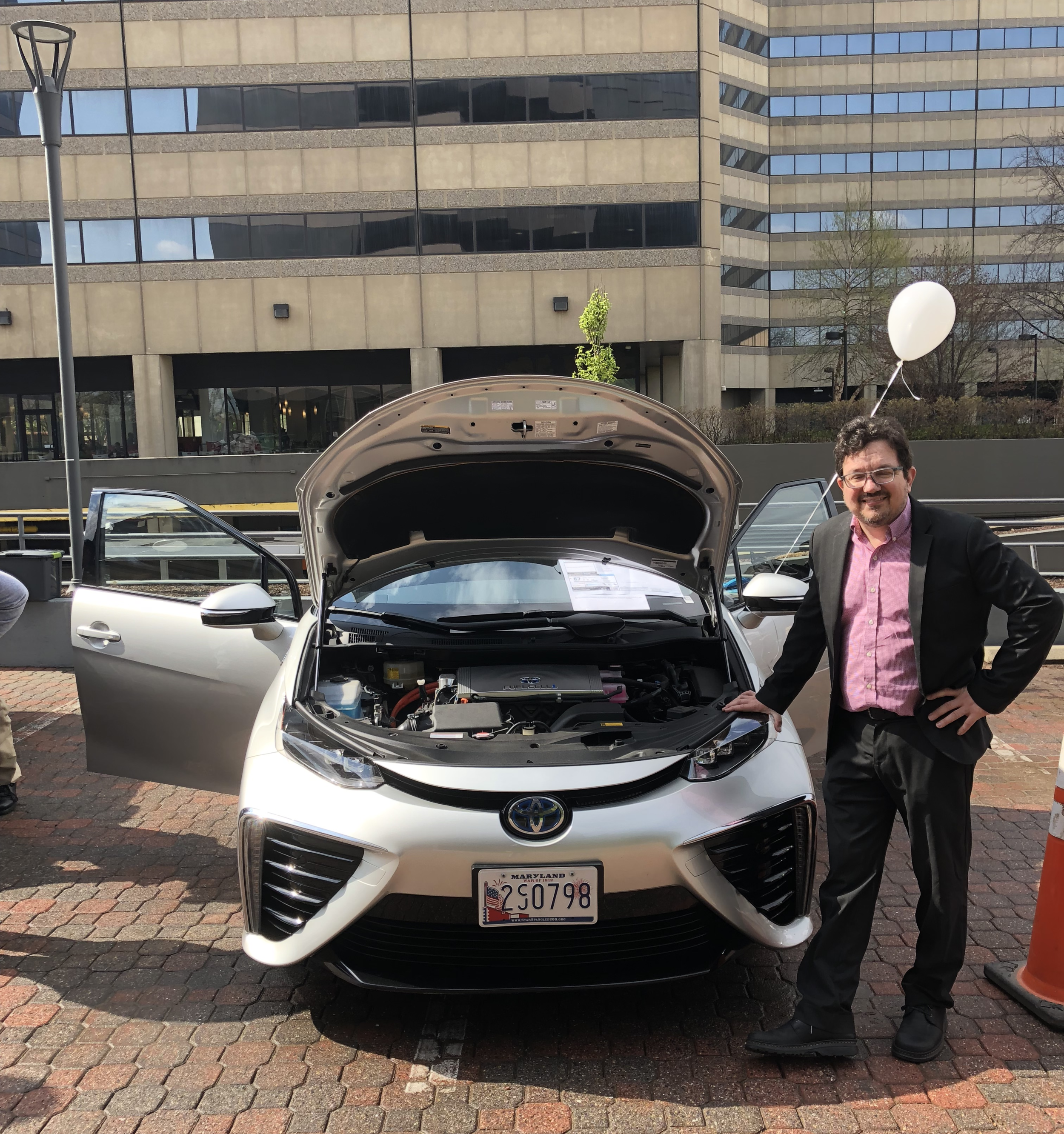 Chris Santucci, Energy Research Manager at Toyota Motor North America, with the 2016 Toyota Mirai fuel cell vehicle at the DEA EV Showcase. Source: FCHEA
