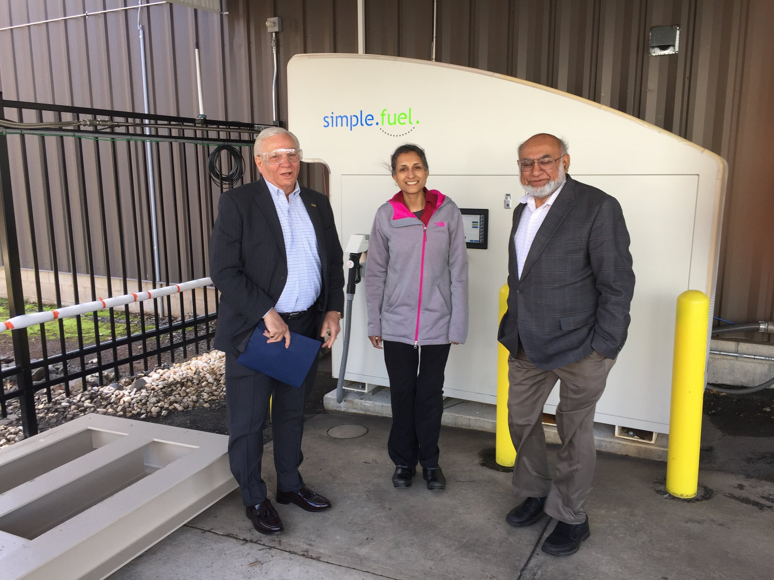 """Left to right: Senator Mensch; Nihad Kaiseruddin, PDC Machines Sales Application Engineer; and Syed Afzal, President of PDC Machines with the """"SimpleFuel"""" on-site hydrogen generation and dispensing appliance."""