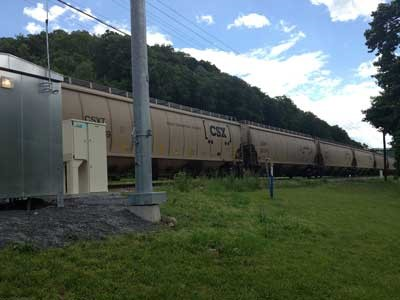 A Plug Power GenSure fuel cell backup power generator (left) on a stretch of CSX railroad. Source: Plug Power