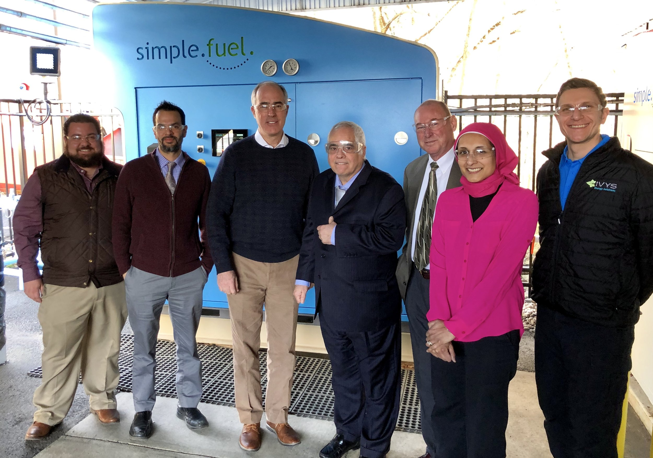 Senator Casey (third from left) with PDC Machines employees in front of SimpleFuel, an on-site hydrogen generation, compression, storage and dispensing appliance that uses water and electricity to produce high purity fuel cell-grade hydrogen.