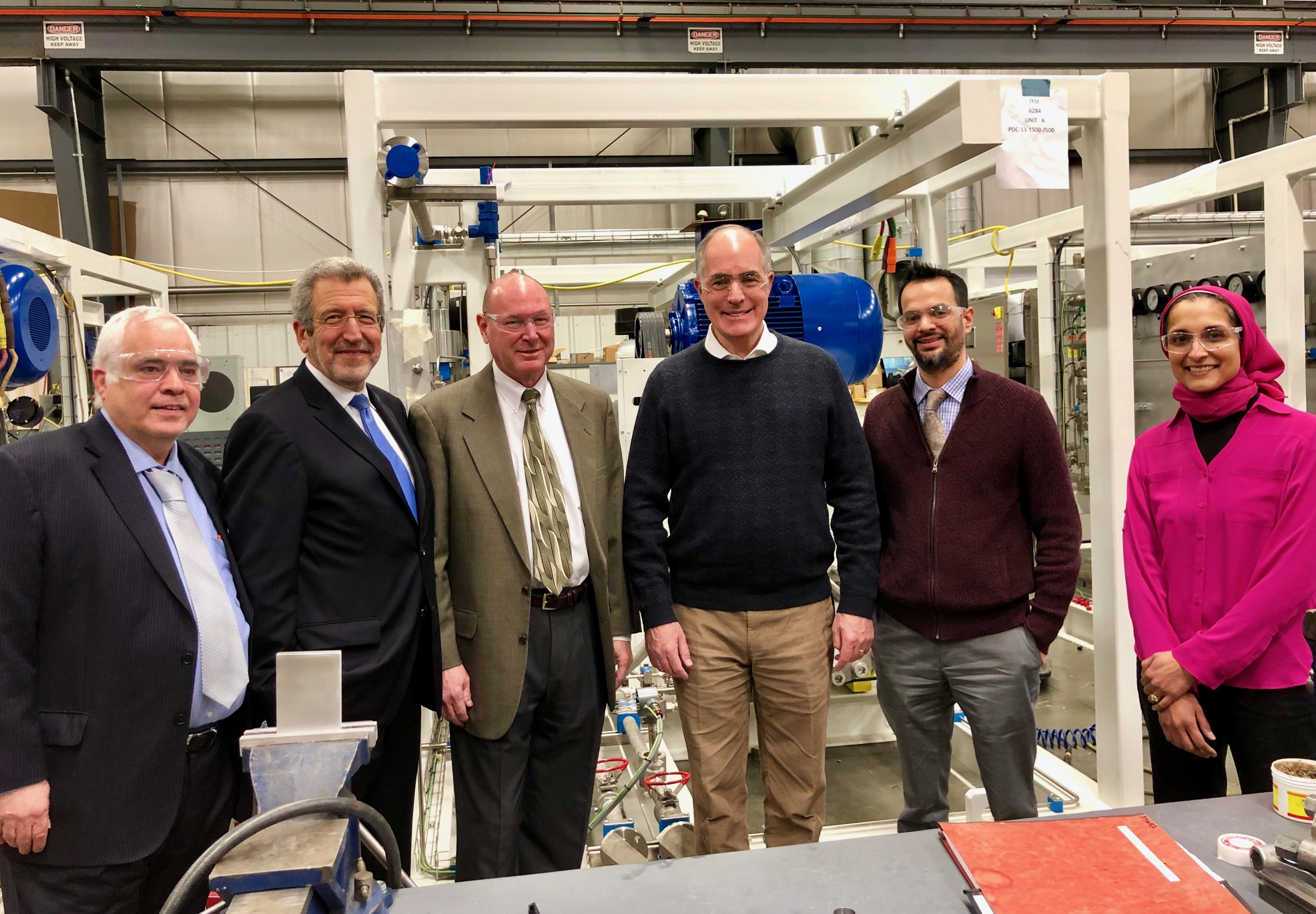 FCHEA President Morry Markowitz (second from left) and Senator Casey (third from right) on the floor of PDC Machines' manufacturing facility in Warminster.