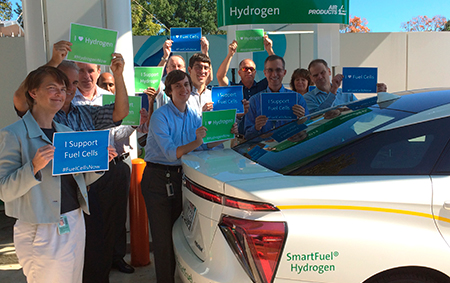 Air Products employees with National Hydrogen & Fuel Cell Day signs for 2017