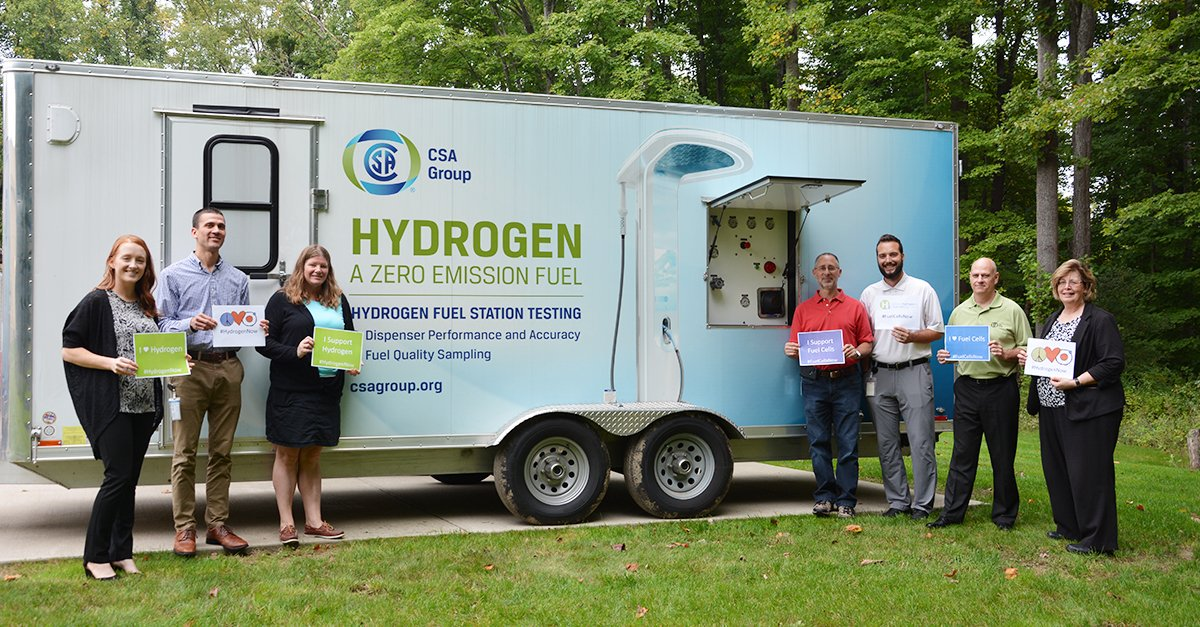 CSA Group employees with National Hydrogen & Fuel Cell Day signs in 2018
