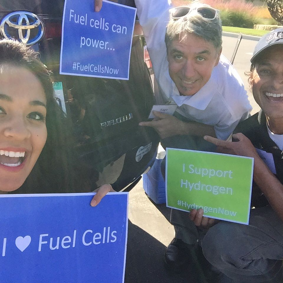 National Hydrogen & Fuel Cell Day signs held with the Toyota Mirai FCV