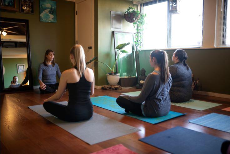 Julie lomax teaches group Restorative flow yoga class