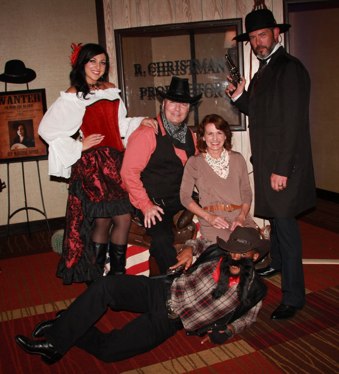 Enjoying the photo booth at the Wild West Showcase with their instructors, Quinton & Theresa MacAdam & Robert Green.