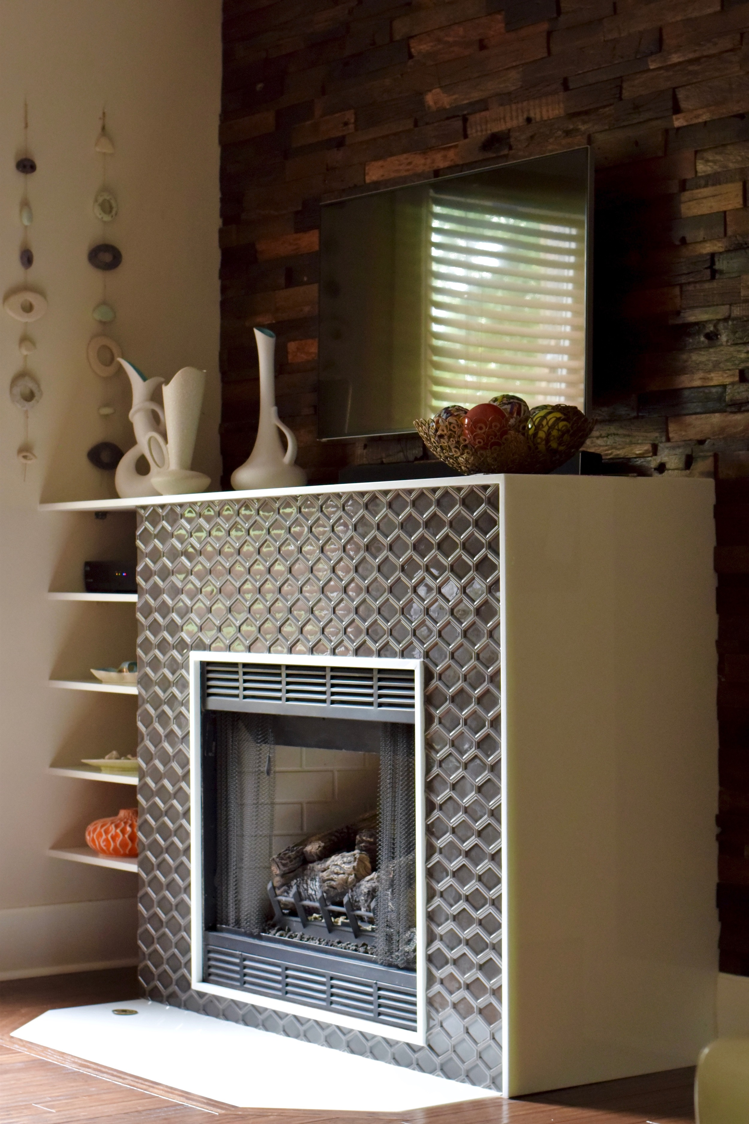 A custom modern glass fireplace with salvaged wood surround.