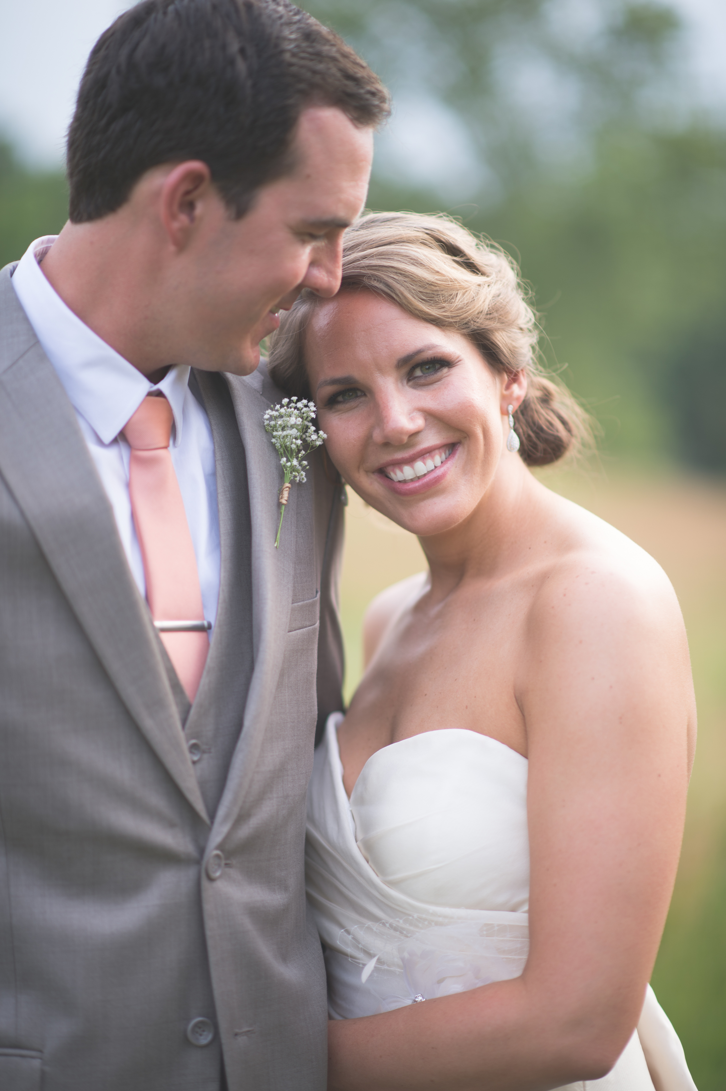 Bride and groom in field at The Darby House