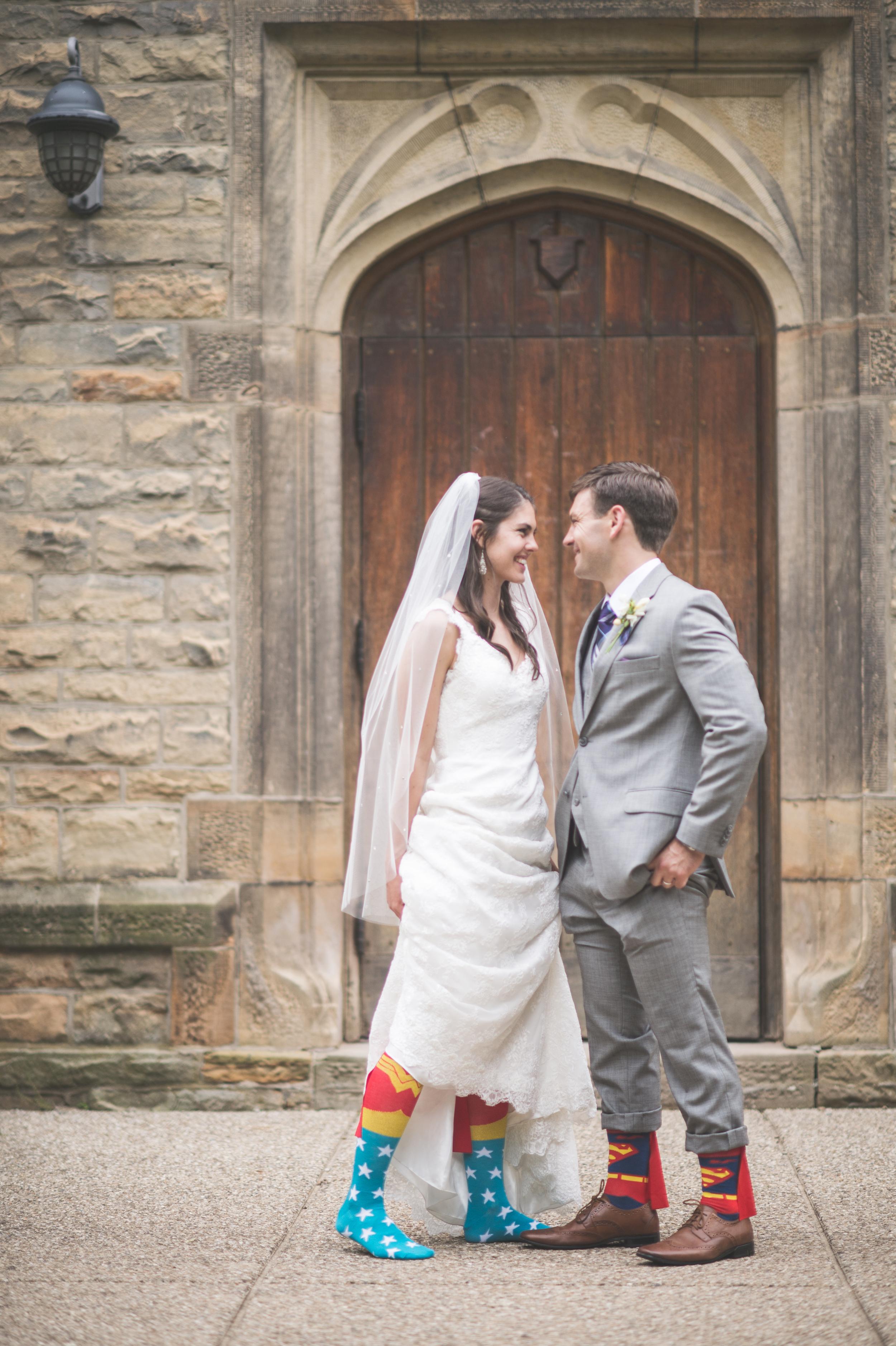 Bride and groom with superhero socks