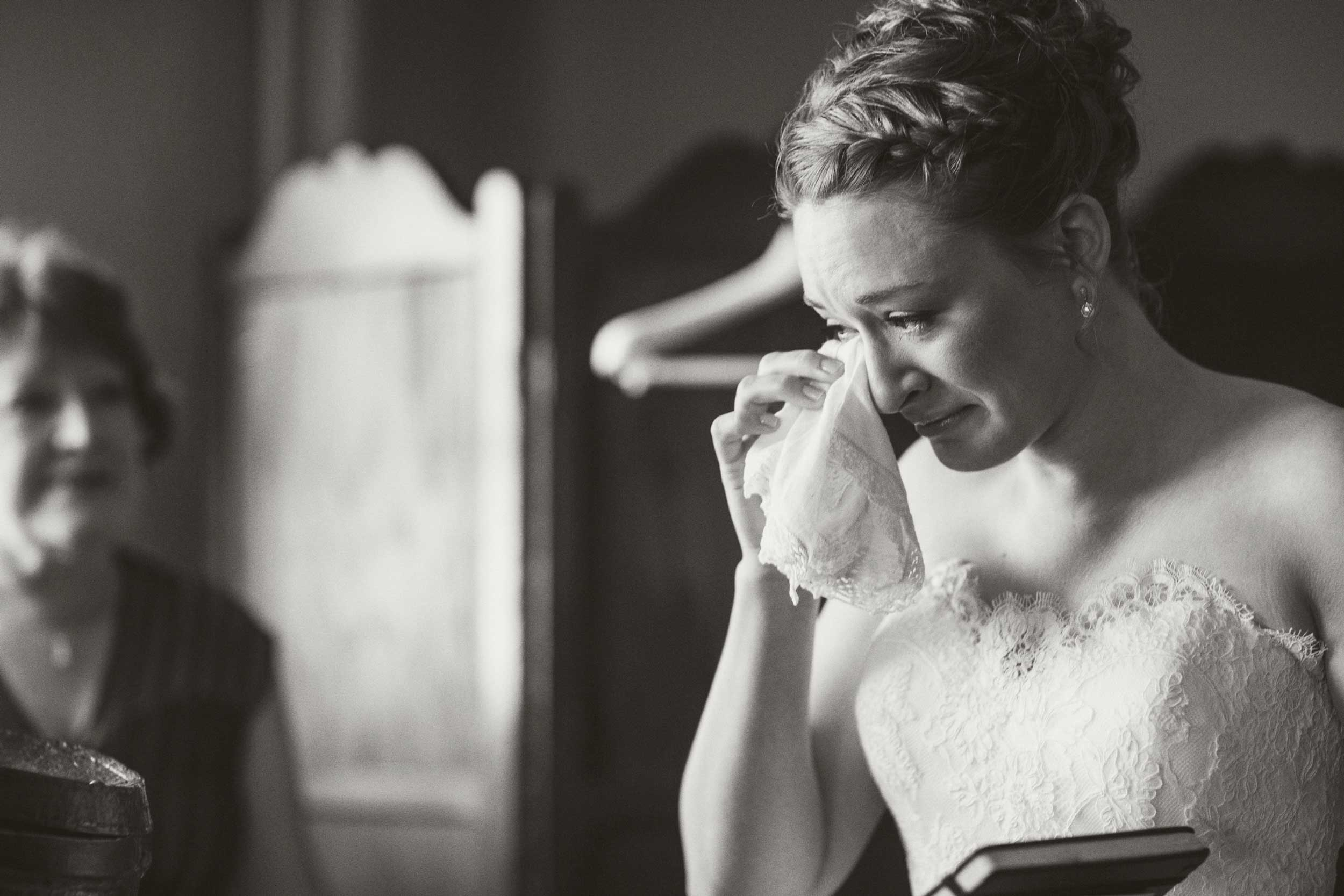 Bride shedding tears after reading the groom's letter to her.