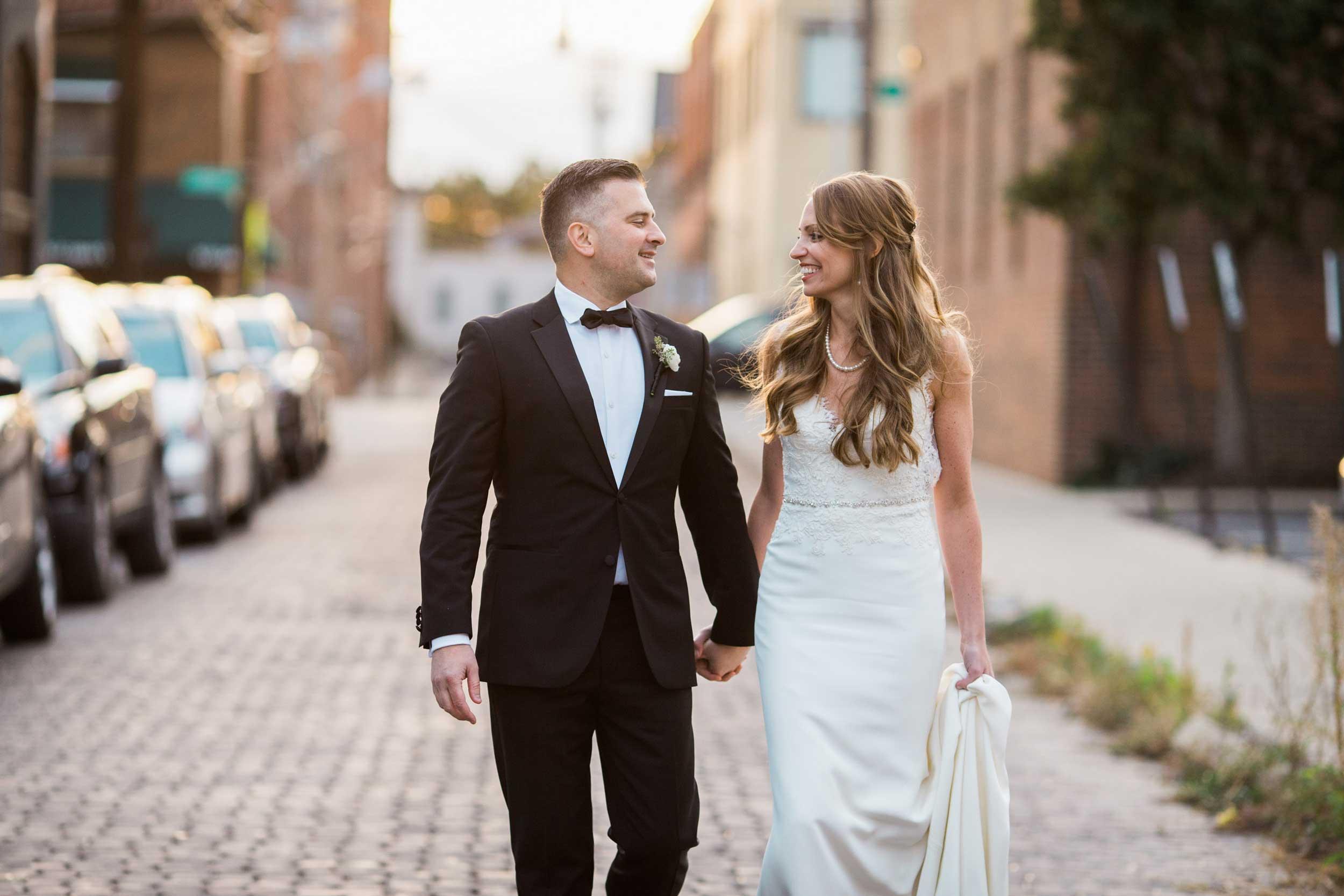 Bride and groom walking in the street in German Village in Columbus, OH