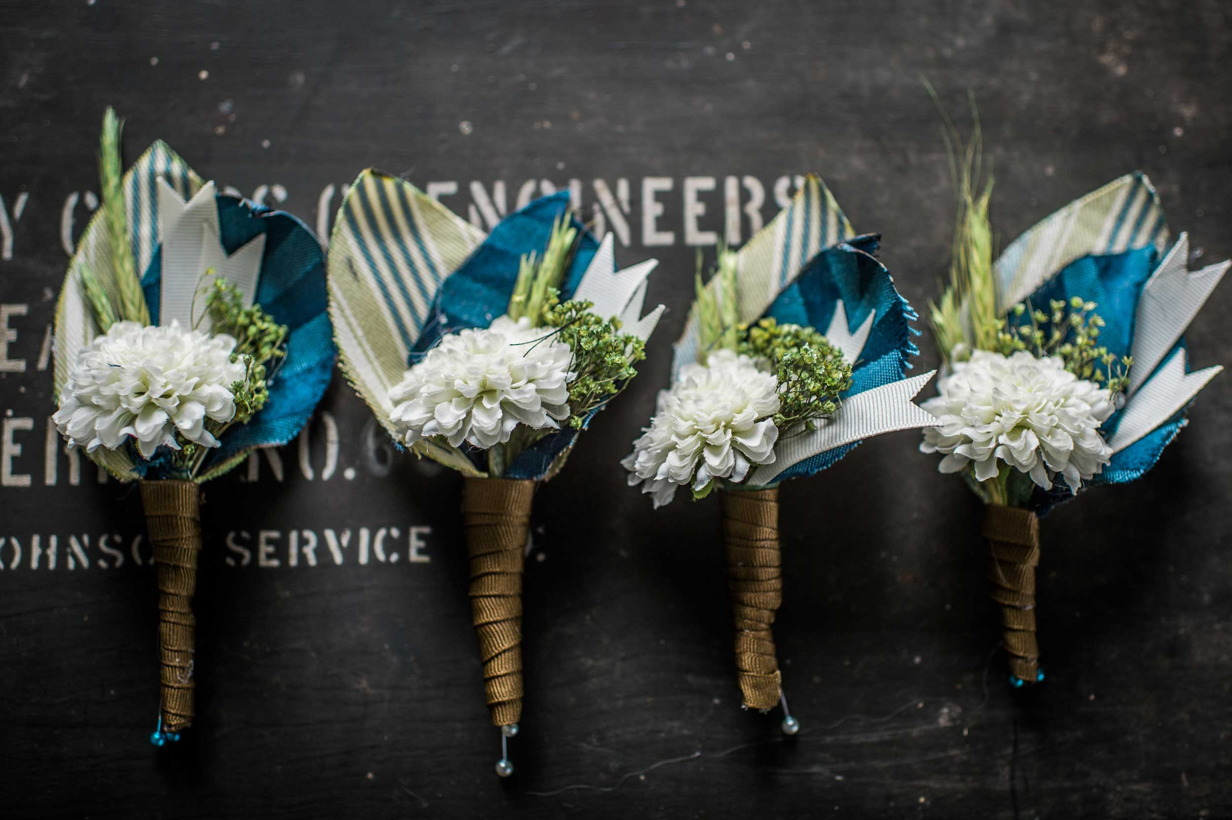 Boutonnieres styled by No Detail Left Behind for a wedding at the Urbana Aviation Museum