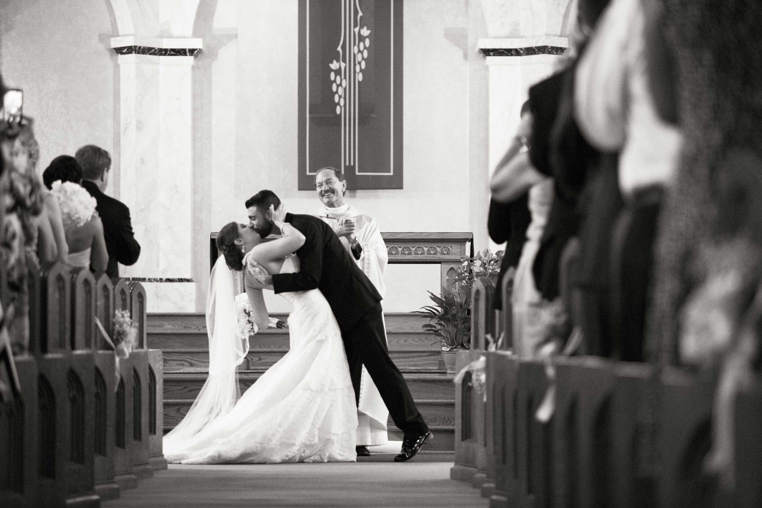 The first kiss at a Youngstown, OH wedding.