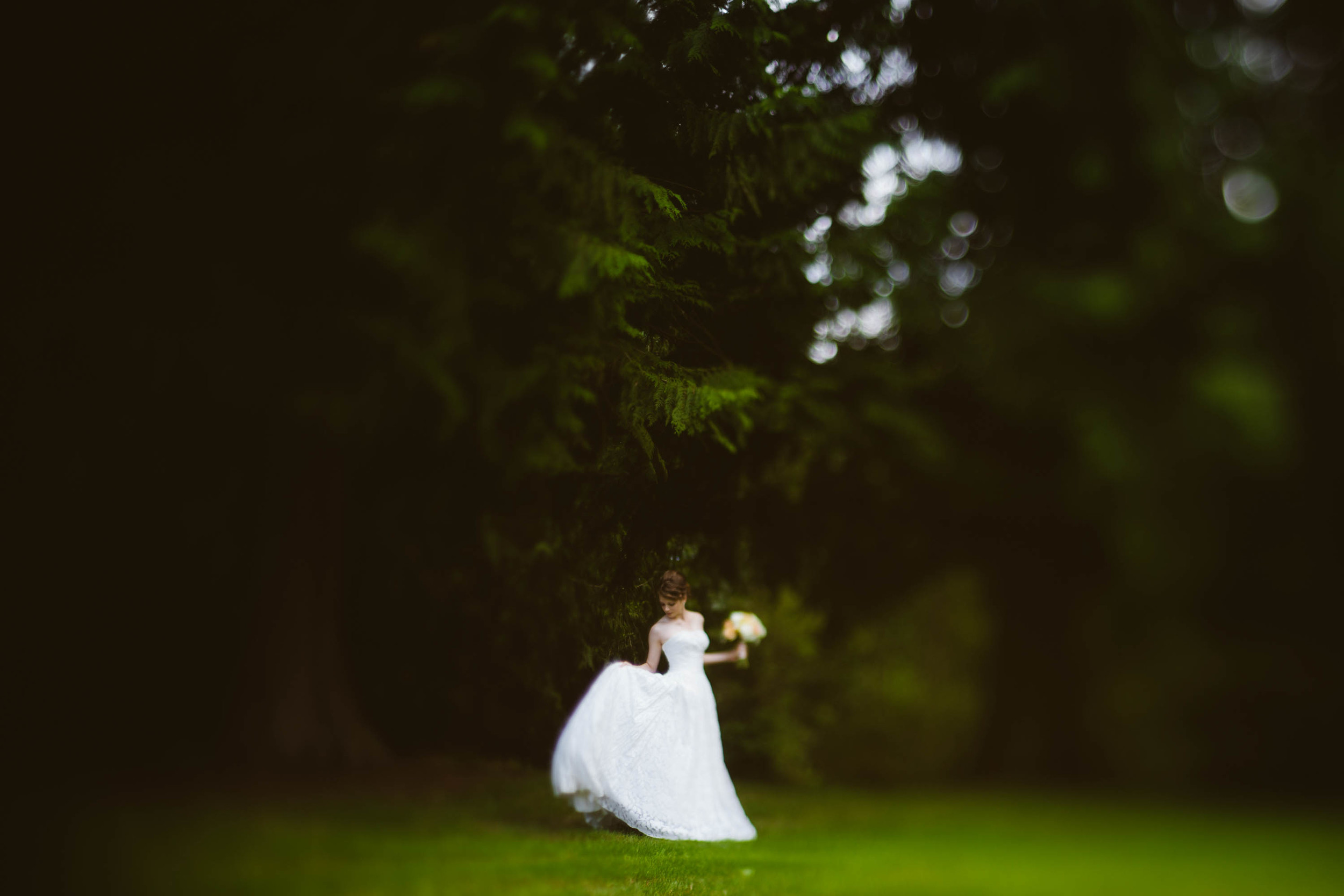 The bride in the dreamlike forest.