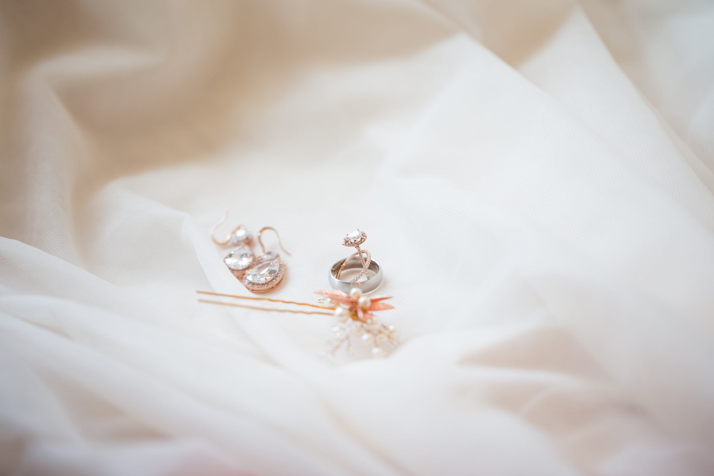 bridal ring, earrings, and brouch
