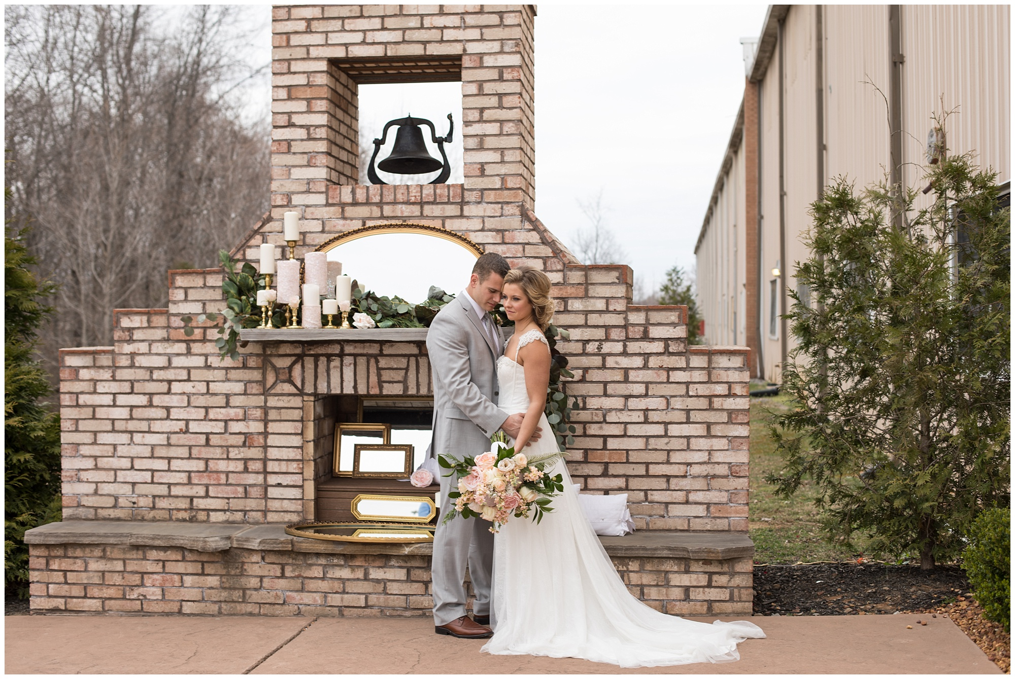 bride and groom in front of fireplace