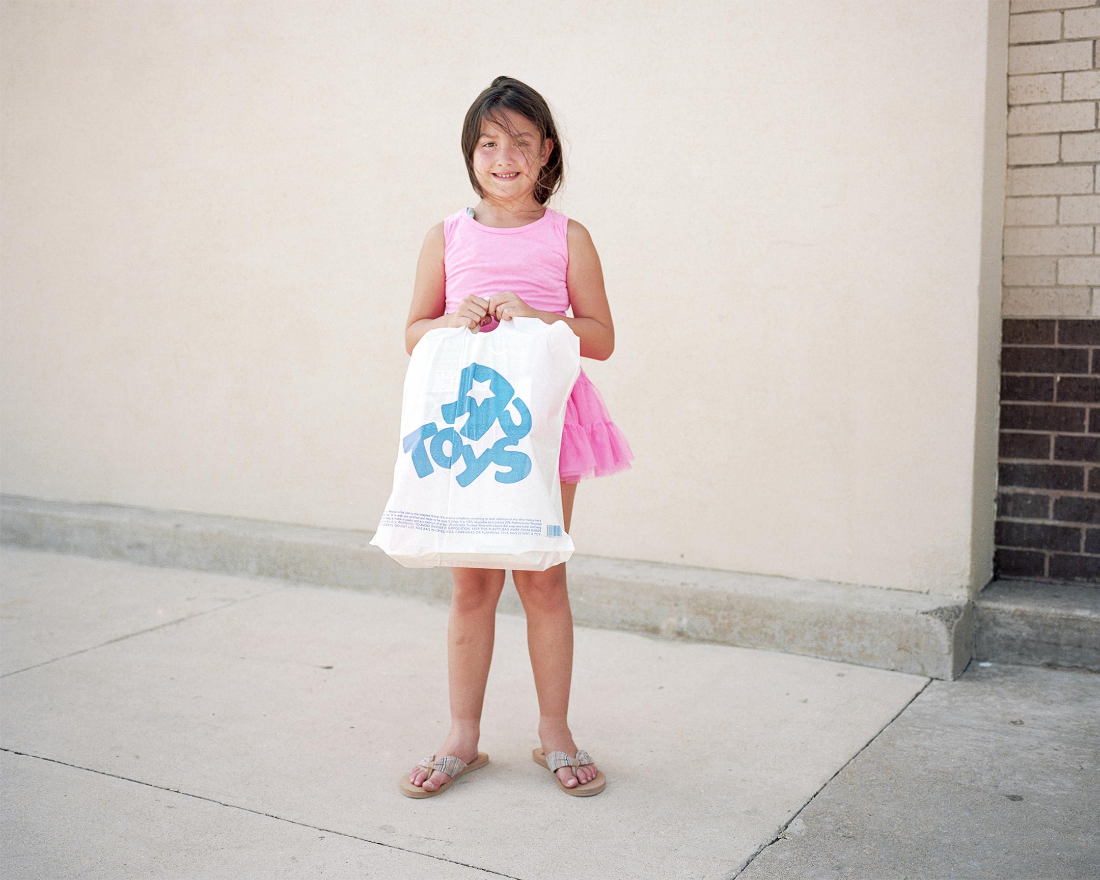 74_Toys_GirlWithShoppingBag.jpg