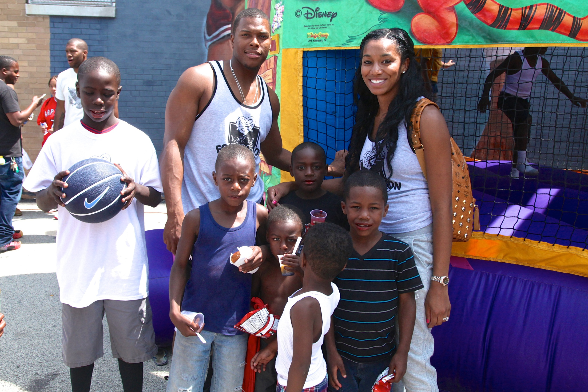 Our founders, Kyle and Ayahna, with a few of our kids at the 2nd Annual Kyle Lowry Community Day.