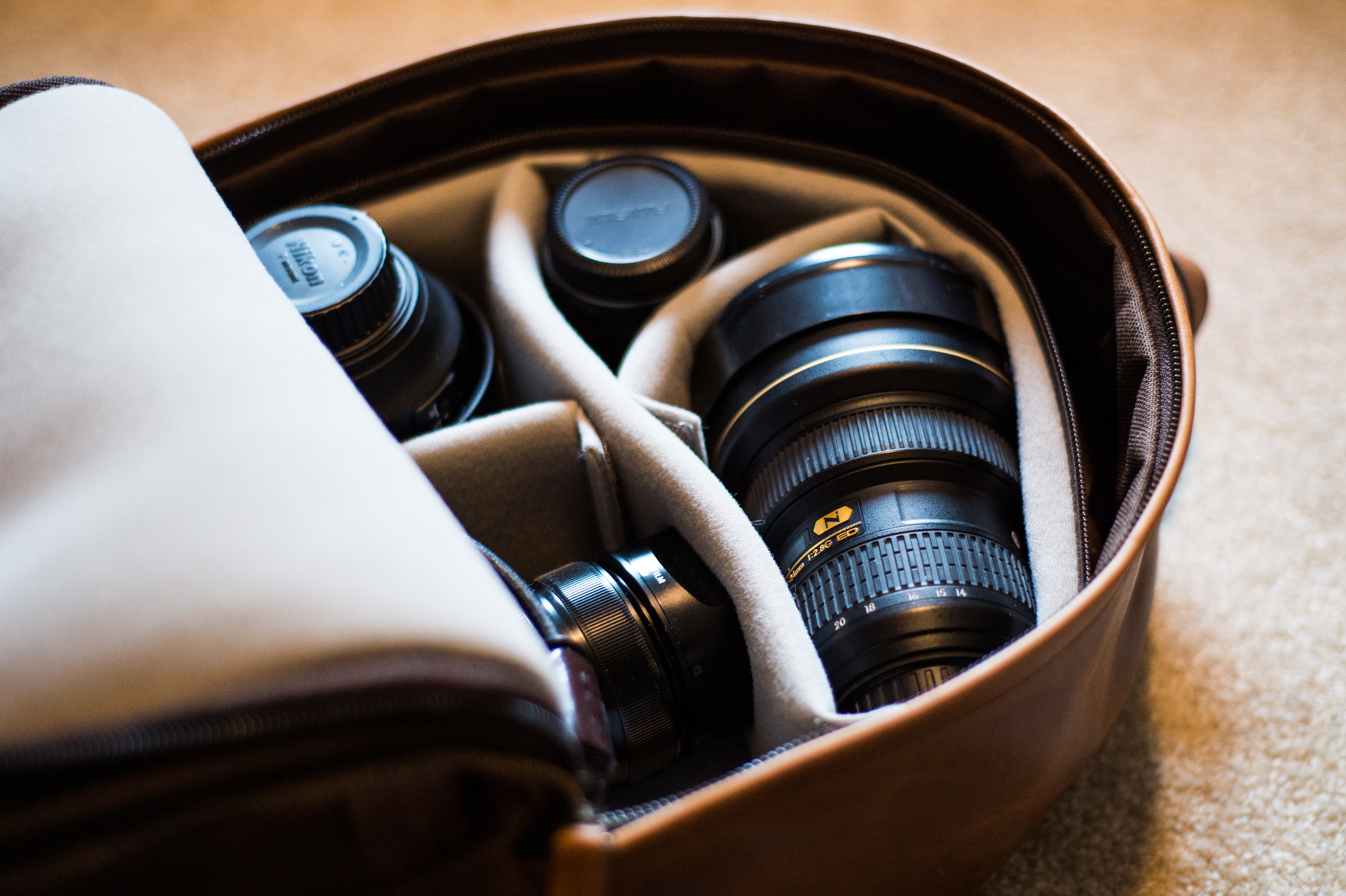 Two FX DSLR Lens, a mirrorless body and a mirrorless lens