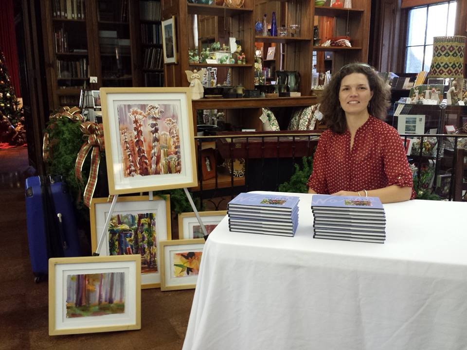 signing books illustrated with my paintings at the Museum open house.