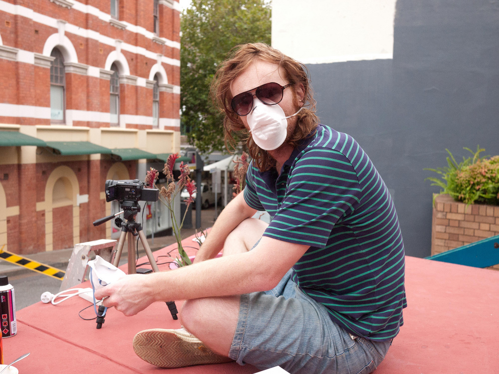Lance filming the Newcastle street mural, 2010