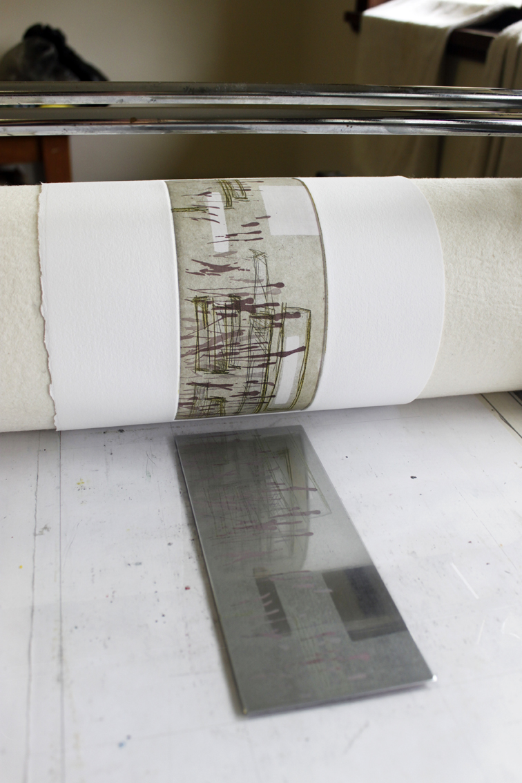 The second plate coming through the press on a three plate etching, soft ground and drypoint.