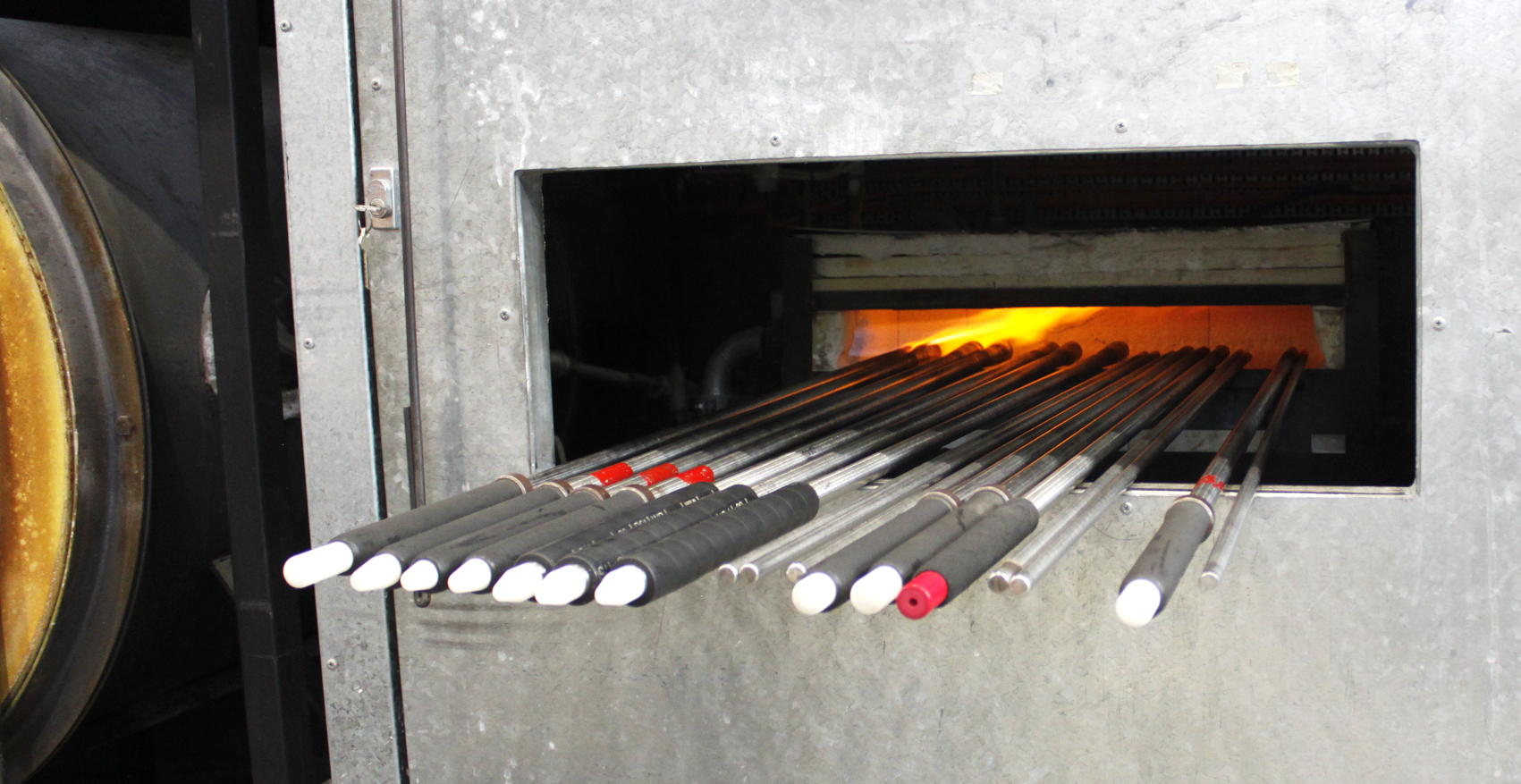 The glass blowing poles heating up.