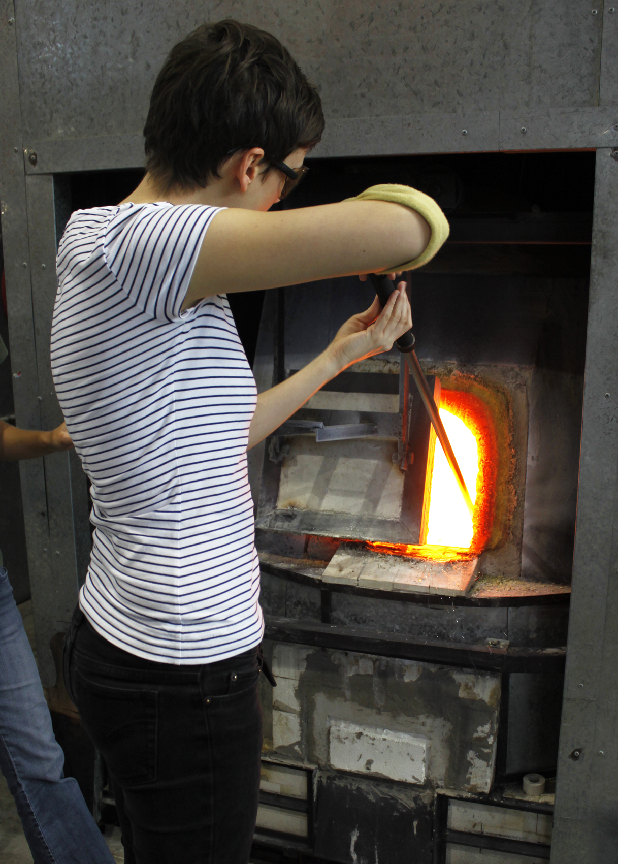 Dipping into the furnace again to enlarge the glass.