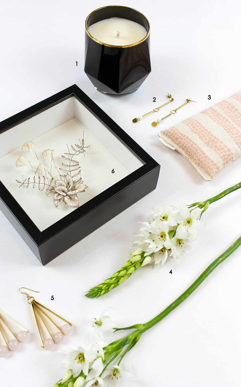 ABOVE: 1. Scented Soy Candle by  Mystique Scents and Creations  2. Brass Earrings by  Madi Young  3. Lavender Eye Pillow by  Oh Hello Henry  4. Fresh Blooms by  Megan Claire Floral Design  5. Brass Earrings by  Madi Young  6. Fine Art Paper Sculpture by  Colleen Southwell.