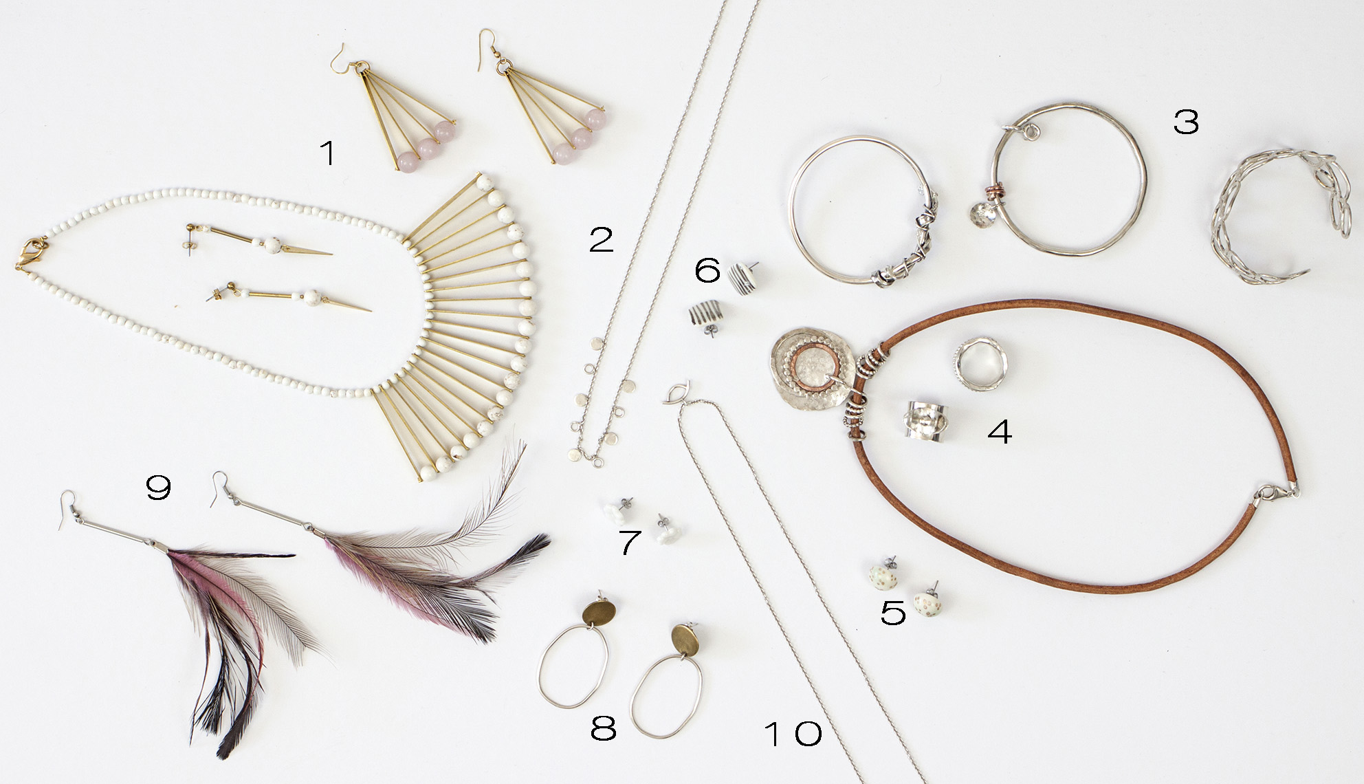 ABOVE 1. Brass Beaded Jewellery by Madi Young , 2. Silver Necklace by I Am Jika , 3. Silver Bangles by White Rock Silver , 4. Silver Necklace and Rings by White Rock Silver , 5. Ceramic Earrings by Amy Burns , 6. Ceramic Earrings by Amy Burns , 7. Ceramic Earrings by Amy Burns , 8. Silver and Brass Earrings by I Am Jika , 9. Feather Earrings by Madi Young , 10. Silver Necklace by I Am Jika .