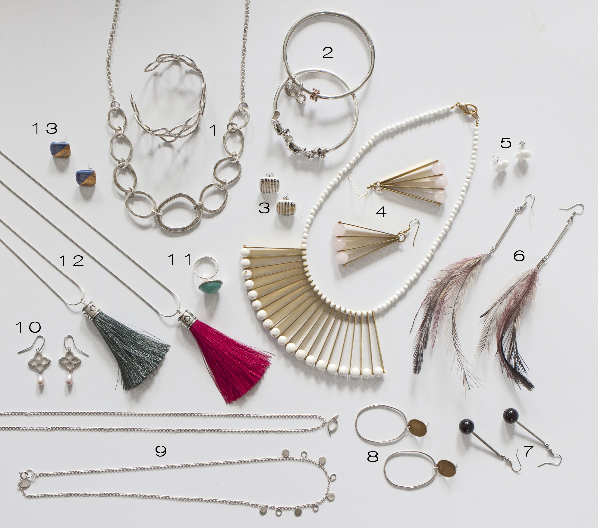 ABOVE 1. Silver Necklace and Bangle by White Rock Silver , 2. Silver Bangles by White Rock Silver , 3. Ceramic Earrings by Amy Burns , 4. Brass and Beaded Jewellery by Madi Young , 5. Ceramic Earrings by Amy Burns , 6. Feather Earrings by Madi Young , 7. Drop Earrings by Madi Young , 8. Silver and Brass Earrings by I Am Jika , 9. Silver Necklaces by I Am Jika , 10. Silver Drop Earrings by A Piece of Work by Cheree , 11. Silver Ring by A Piece of Work by Ceree , 12. Tassel Necklaces by A Piece of Work by Cheree , 13. Ceramic Earrings by Amy Burns .
