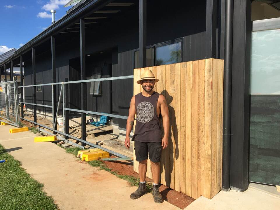 Erick building the new fence, 2017.