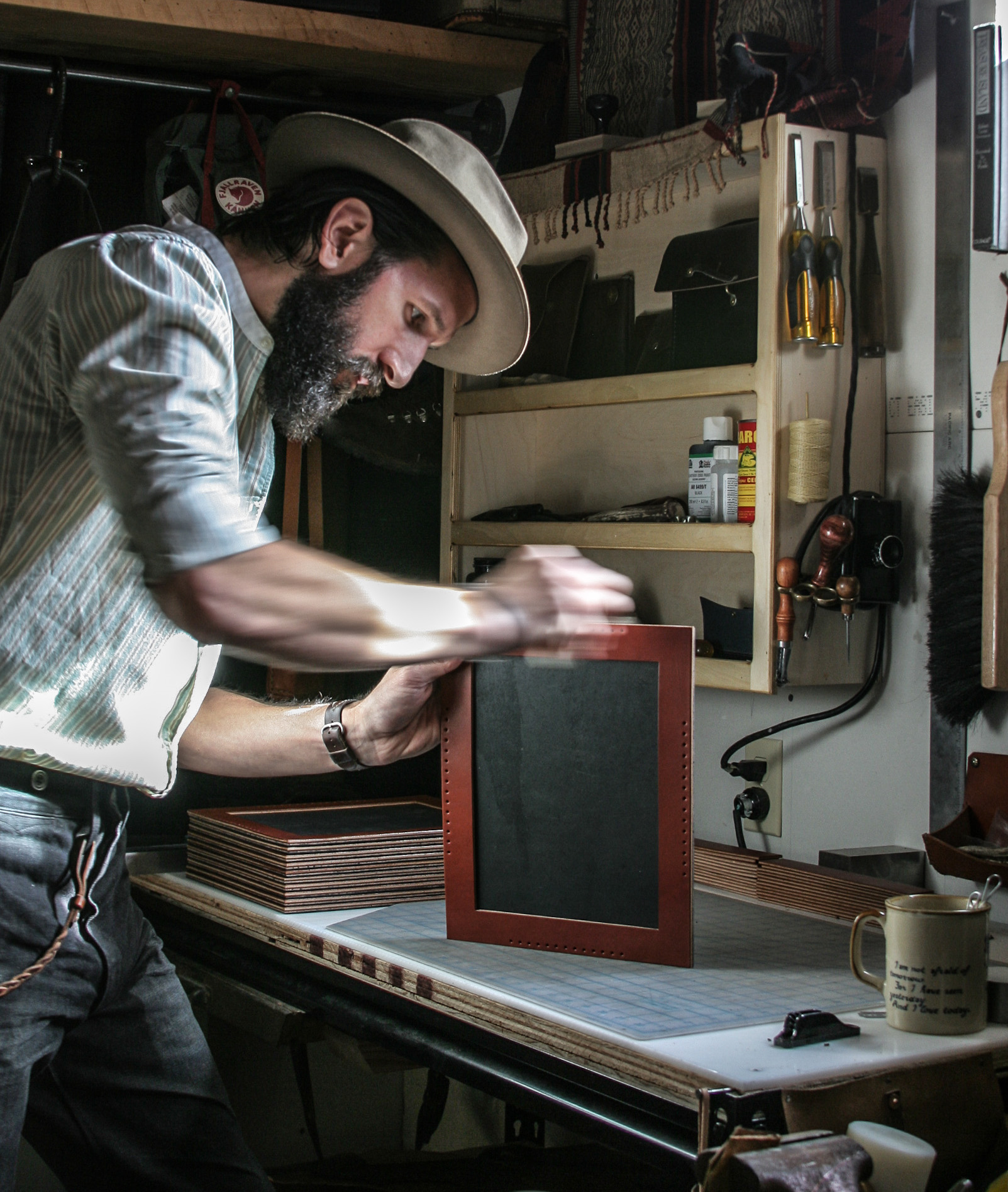 Live and Learn - Here, I'm burnishing up the edges on a set of large 8x10 leather pictures frames I designed, which were picked up by Filson in the 2015 Fall season.  I loved the look of these frames, but they would have been better designed to hang from a wall, rather than kickstand on a desk.  Live and learn, and that's the game.  Next time!
