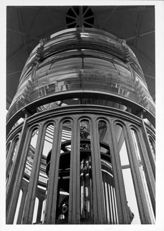 Interior of Point Pinos Lighthouse tower (lantern room), showing close-up of fixed third-order Fresnel lens and inner eclipser mechanism.