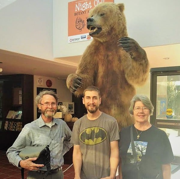Collections Curator Paul Van de Carr (center) with Richard Anderson and his wife Lynn Hansen.