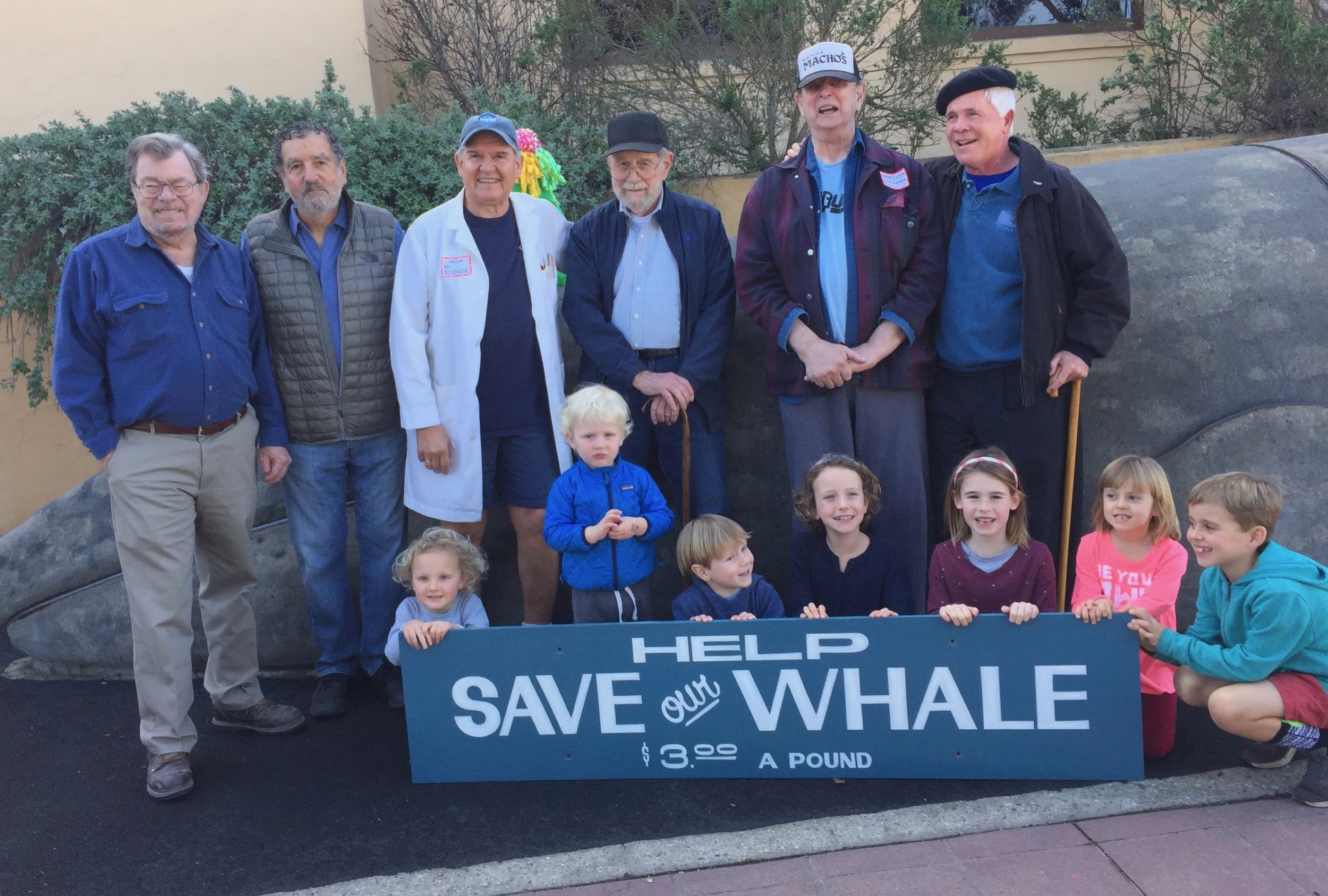'Whale Fund ' g roup that led the way in making Pacific Grove Sandy's forever home.   (Standing left to right)  Puckett, David Shonman, Milos Radakovich, Vern Yadon, Larry Foster and Paul Finnegan.   (Front)  Sandy's fans celebrating her birthday and enjoying  Science Saturday  activities.