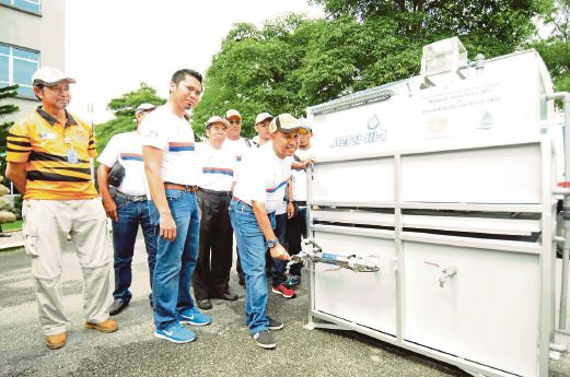 Puncak Niaga Holdings Bhd executive chairman Tan Sri Rozali Ismail demonstrating how to use its portable field water purification system, Jernih. The company's current revenue is derived from environmental engineering business that comprises water and wastewater.