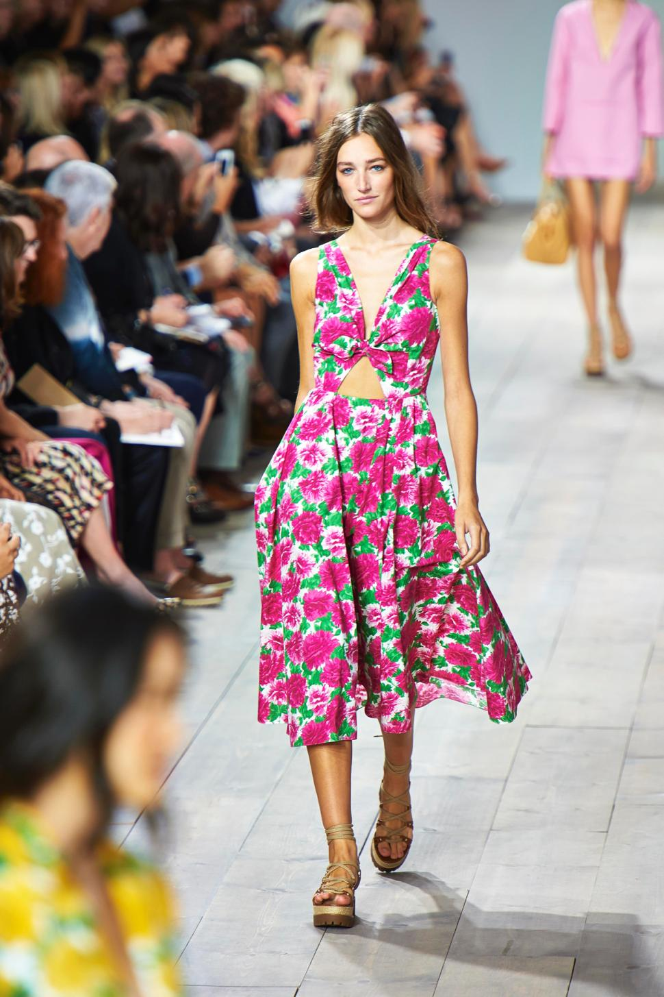Michael   Kors     This dress is the definition of Spring with its flowery and colorful print. I could see this easily translating from day to night with the right accessories while on a vacation.