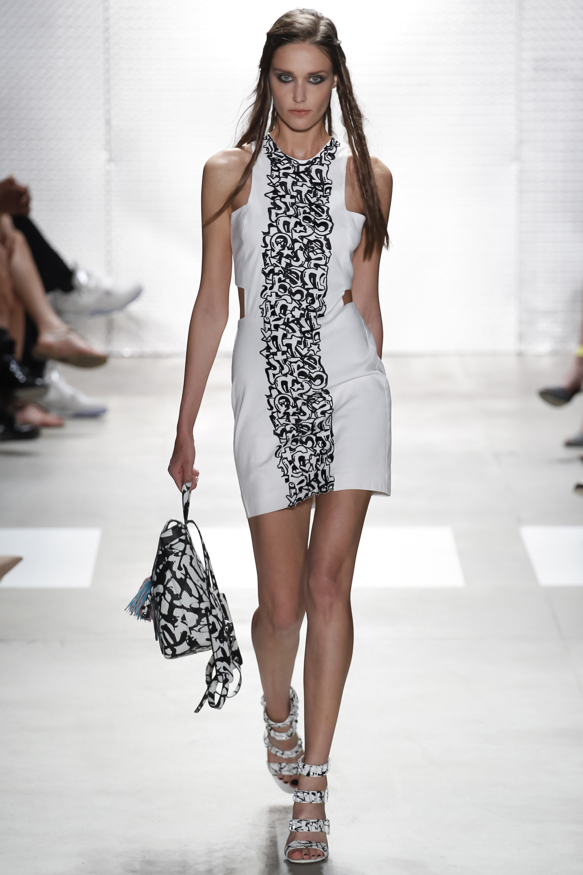 Nicole Miller    I'm getting a go-go dancer feel from this dress, but at the same time it's really chic because of the black and white color scheme. I'm all about matching so I love that the bag and shoes have the same print as the dress.