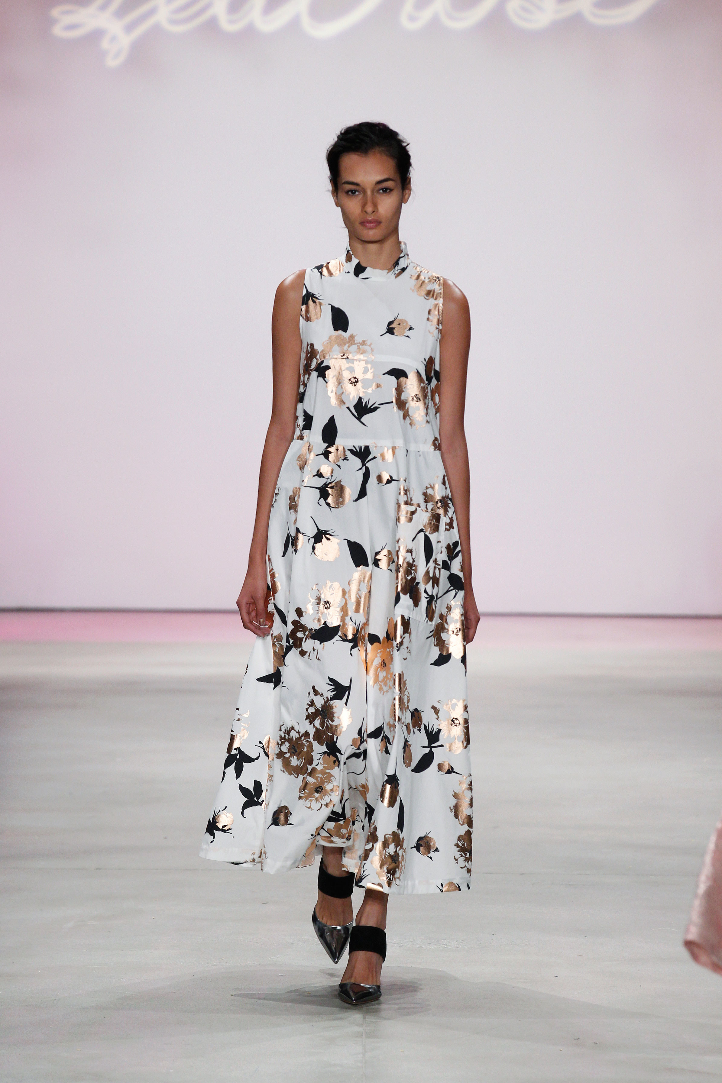 Lela Rose    This dress's white canvas is a great contrast to the black and gold metallic print and I'm a big fan of pointed toe shoes—they really add to the entire silhouette of the look.