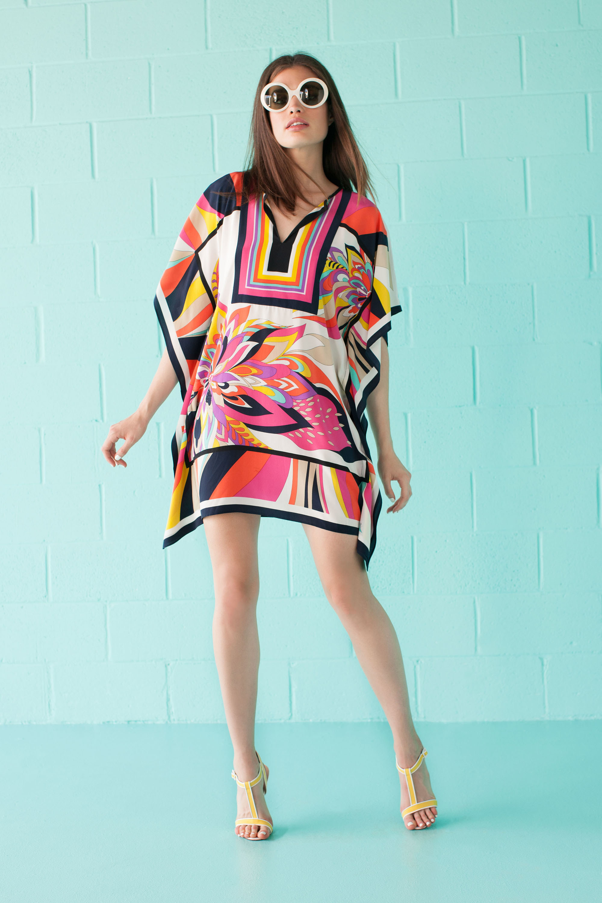 Trina Turk    Wow, this look is so retro and fun! The big, round sunglasses and dainty, yellow heels are perfect with the slightly over-sized look of the dress.
