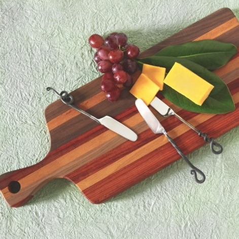 This Authentic Fair Trade cutting board was ethically sourced and handmade in Cameroon. One of this product's contributing craftsmen is Njinuwo Richard, who wants to run his own workshop someday. This design is unique for its incorporation of many different wood colors.